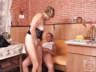 Mature mother and the Son's friend have a good time on kitchen. anal films